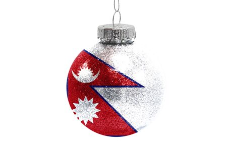 Glass Christmas ball toy isolated on white background with the flag of Nepal Фото со стока