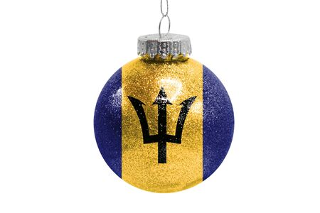 Glass Christmas ball toy isolated on white background with the flag of Barbados