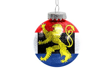 Glass Christmas ball toy isolated on white background with the flag of Benelux