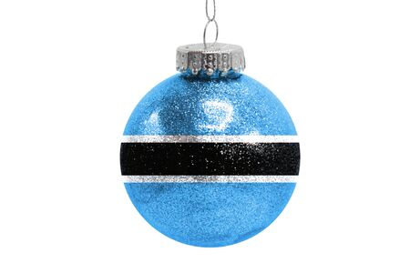 Glass Christmas ball toy isolated on white background with the flag of Botswana Фото со стока