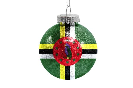 Glass Christmas ball toy isolated on white background with the flag of Dominica