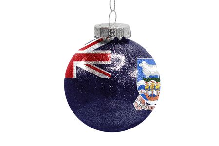 Glass Christmas ball toy isolated on white background with the flag of Falkland Islands