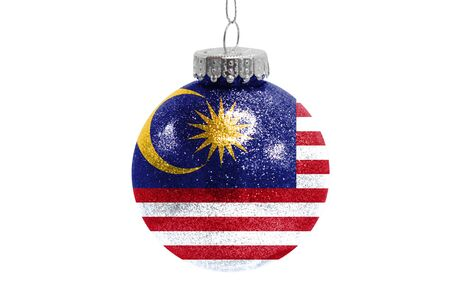 Glass Christmas ball toy isolated on white background with the flag of Malasia