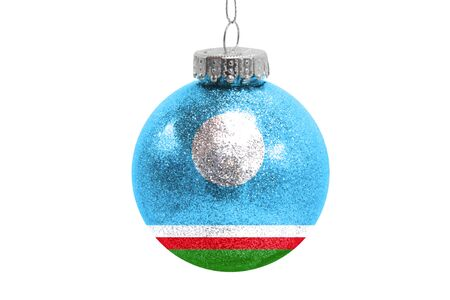 Glass Christmas ball toy isolated on white background with the flag of Sakha Republic Фото со стока