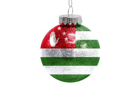 Glass Christmas ball toy isolated on white background with the flag of Abkhazia