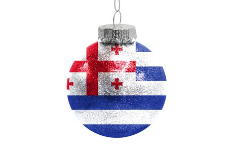 Glass Christmas ball toy isolated on white background with the flag of Adjara Фото со стока