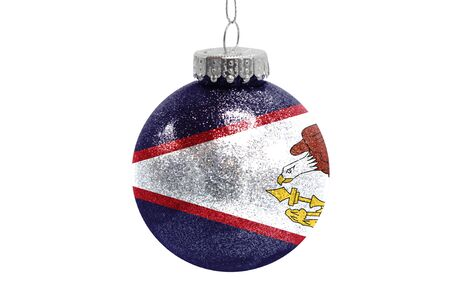 Glass Christmas ball toy isolated on white background with the flag of American Samoa Фото со стока