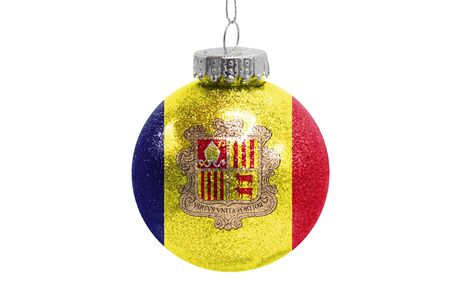 Glass Christmas ball toy isolated on white background with the flag of Andorra Фото со стока