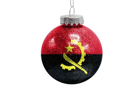 Glass Christmas ball toy isolated on white background with the flag of Angola Фото со стока