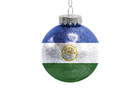 Glass Christmas ball toy isolated on white background with the flag of Bashkortostan