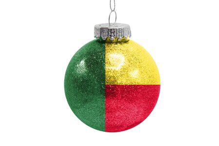 Glass Christmas ball toy isolated on white background with the flag of Benin