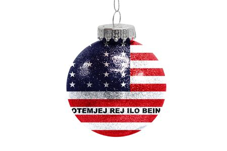 Glass Christmas ball toy isolated on white background with the flag of Bikini Atoll