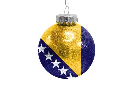 Glass Christmas ball toy isolated on white background with the flag of Bosnia and Herzegovina Фото со стока