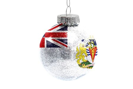 Glass Christmas ball toy isolated on white background with the flag of British Antarctic Territory Фото со стока