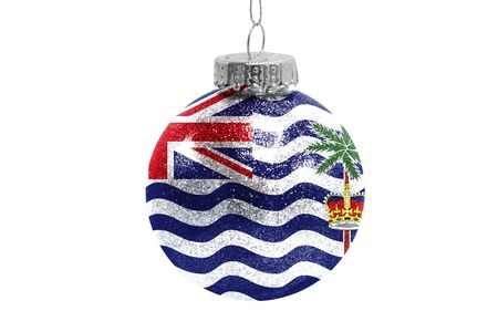 Glass Christmas ball toy isolated on white background with the flag of British Territory in the Indian Ocean Фото со стока