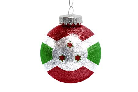 Glass Christmas ball toy isolated on white background with the flag of Burundi
