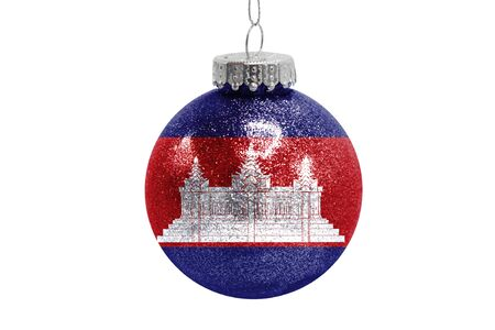 Glass Christmas ball toy isolated on white background with the flag of Cambodia Фото со стока