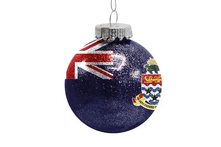 Glass Christmas ball toy isolated on white background with the flag of Cayman islands Фото со стока
