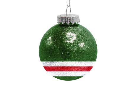 Glass Christmas ball toy isolated on white background with the flag of Chechen Republic of Ichkeria