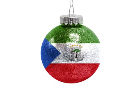 Glass Christmas ball toy isolated on white background with the flag of Equatorial Guinea