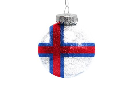 Glass Christmas ball toy isolated on white background with the flag of Faroe Islands