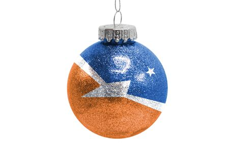 Glass Christmas ball toy isolated on white background with the flag of Tierra del Fluego Province Argentina Фото со стока