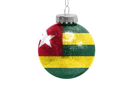 Glass Christmas ball toy isolated on white background with the flag of Togo