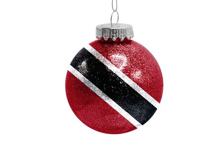 Glass Christmas ball toy isolated on white background with the flag of Trinidad and Tobago