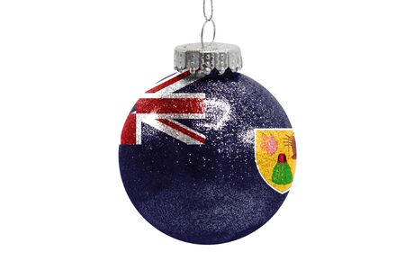 Glass Christmas ball toy isolated on white background with the flag of Turks and Caicos Islands