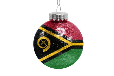 Glass Christmas ball toy isolated on white background with the flag of Vanuatu
