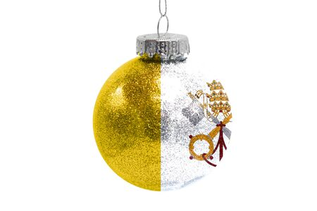 Glass Christmas ball toy isolated on white background with the flag of Vatican city Holy see Фото со стока