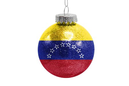 Glass Christmas ball toy isolated on white background with the flag of Venezuela