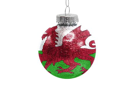 Glass Christmas ball toy isolated on white background with the flag of Wales