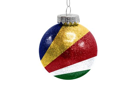 Glass Christmas ball toy isolated on white background with the flag of Seychelles Фото со стока