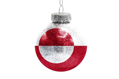 Glass Christmas ball toy isolated on white background with the flag of Greenland