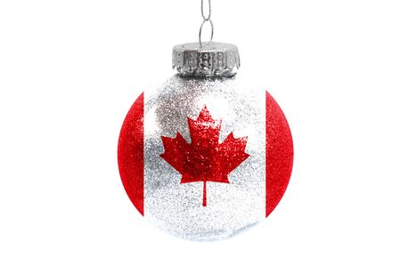 Glass Christmas ball toy isolated on white background with the flag of Canada