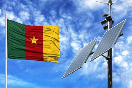 Solar panels on a background of blue sky with a flagpole and the flag of Cameroon