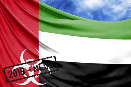 Novel coronavirus disease named 2019-nCoV with United Arab Emirates flag closeup on blue sky background Stock Photo