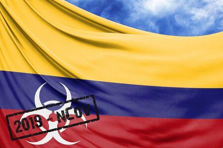 Novel coronavirus disease named 2019-nCoV with Colombia flag closeup on blue sky background