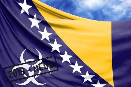 Novel coronavirus disease named 2019-nCoV with Bosnia and Herzegovina flag closeup on blue sky background