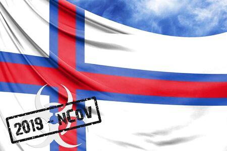 Novel coronavirus disease named 2019-nCoV with Faroe Islands flag closeup on blue sky background Stock Photo