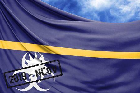 Novel coronavirus disease named 2019-nCoV with Nauru flag closeup on blue sky background Stock Photo