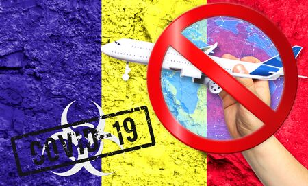 Novel coronavirus disease named COVID - 19, with the flag of Romania shown against a cracked wall, contains the concept of a ban on air travel between countries Stockfoto