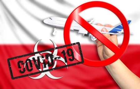 A new coronavirus disease called COVID - 19 with the flag of Poland. Contains the concept of a ban on air travel between countries. Stockfoto