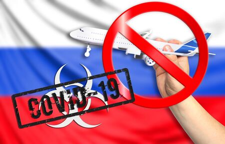 A new coronavirus disease called COVID - 19 with the flag of Russia. Contains the concept of a ban on air travel between countries.