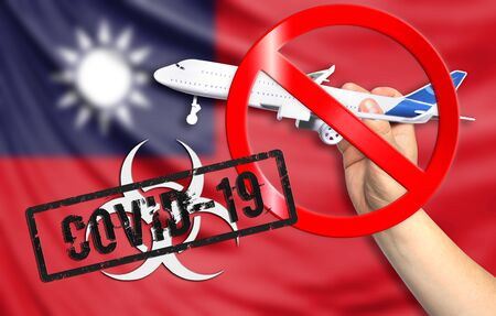 A new coronavirus disease called COVID - 19 with the flag of Taiwan. Contains the concept of a ban on air travel between countries.