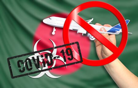 A new coronavirus disease called COVID - 19 with the flag of Bangladesh. Contains the concept of a ban on air travel between countries. Фото со стока
