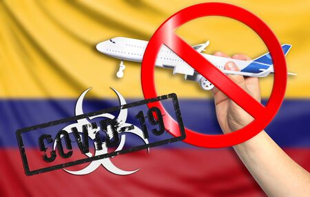 A new coronavirus disease called COVID - 19 with the flag of Colombia. Contains the concept of a ban on air travel between countries.