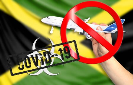 A new coronavirus disease called COVID - 19 with the flag of Jamaica. Contains the concept of a ban on air travel between countries.