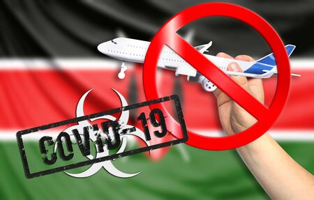 A new coronavirus disease called COVID - 19 with the flag of Kenya. Contains the concept of a ban on air travel between countries. Фото со стока